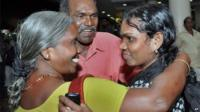 Indian nurse evacuated from Yemen, right, is welcomed by her parents upon arrival in Kochi, India