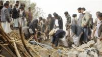 Yemenis search for survivors in the rubble of houses destroyed by Saudi-led airstrikes in a village near Sanaa, Yemen on 4 April 4, 2015.