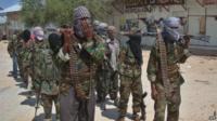 Al-Qaeda linked al-shabab recruits walk down a street on March 5, 2012 in the Deniile district of Somalian capital, Mogadishu, following their graduation