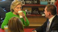 Hillary Clinton has coffee with local residents at the Jones Street Java House during a campaign visit April 14, 2015 in Le Claire, Iowa.