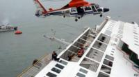 In this image taken from video released by News Y via Yonhap, passengers from a ferry sinking off South Korea's southern coast, are rescued by a South Korean Coast Guard helicopter in the water off the southern coast near Jindo, south of Seoul, Wednesday, 16 April 2014