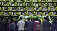 People pay a tribute at a group memorial altar for the victims of the sunken South Korean ferry Sewol at a remembrance hall in Ansan on 16 April 2015