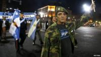 Veterans of the 1982 Falklands War marching on the eve of the 33rd anniversary of the conflict