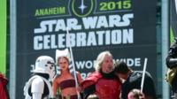 Fans dressed in costumes attend on the opening day of the 25th Star Wars Convention on 16 April, 2015 in Anaheim, California