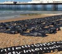 Body bags on Brighton beach
