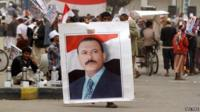 A man carries a poster of former Yemeni President Ali Abdullah Saleh at a protest in Sanaa, 3 April 2015