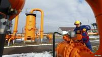 An engineer checks gas pipe supply in Europe