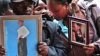 Relatives hold portraits of those killed during the attack on Garissa University College, Nairobi, Kenya - 9 April 2015
