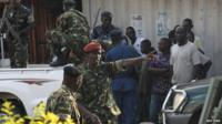 Burundi former Defence Minister Cyrille Ndayirukiye points to a direction during a attempted coup in the capital Bujumbura, on 13 May 2015.