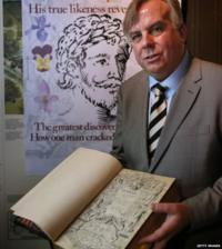 Historian Mark Griffiths holds a copy of The Herball book