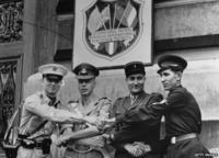 Four soldiers from the Occupying powers shake hands to mark the end of the International Patrol in Vienna.