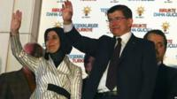 Turkey's Prime Minister and leader of ruling Justice and Development Party Ahmet Davutoglu and his wife Sare Davutoglu wave to supporterson 7 June