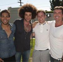 Simon Cowell and his three finalists