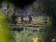 Pakistan army soldiers stand guard near the Abbottabad compound