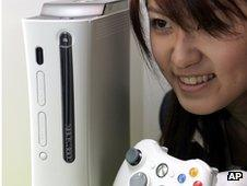 Girl looks at Xbox