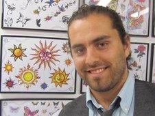 Horamis Fotis at a tattoo parlour