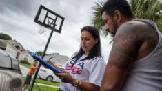 Soraya Marquez, the state coordinator for Mi Familia Vota and her crew hit a Puerto Rican neighborhood trying to get Latinos to register to vote