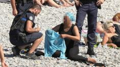 Police patrolling in Nice fine a woman for wearing a burkini