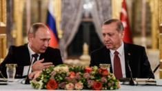 This file photo taken on October 10, 2016 shows Russian President Vladimir Putin (L) speaking to Turkish President Recep Tayyip Erdogan (R) as they attend a press conference in Istanbul.