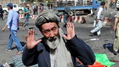 A man from Hazara minority reacts after a suicide bomb attack that targeted a demonstration of Hazara minority in Kabul, Afghanistan, 23 July 2016.