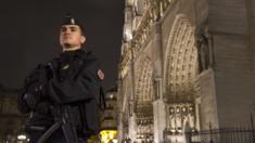 A French gendarme in front of the Notre Dame cathedral