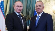 Russia's president Vladimir Putin (L) and Uzbekistan's president Islam Karimov