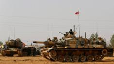 Turkish army tanks and military personal are stationed in Karkamis on the Turkish-Syrian border in the south-eastern Gaziantep province, Turkey, August 25, 2016.