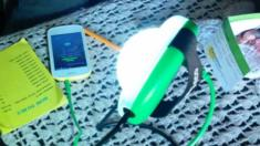 Solar lamp charging mobile phone