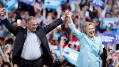 Democratic presidential candidate Hillary Clinton arrives with Sen. Tim Kaine, D-Va., at a rally at Florida International University Panther Arena in Miami, Saturday, July 23, 2016. Clinton has chosen Kaine to be her running mate.