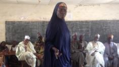 A woman speaks during community leaders meeting in Nigeria's Adamawa state