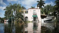 A home is seen surrounded by flood water caused by the combination of the lunar orbit which caused seasonal high tides and what many believe is the rising sea levels due to climate change on September 30, 2015 in Fort Lauderdale, Florida
