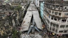 General view shows a partially collapsed overpass in Kolkata, India, Friday, April 1, 2016.