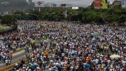 Demonstrators during an opposition protest in Caracas, Venezuela, on 19 April 201