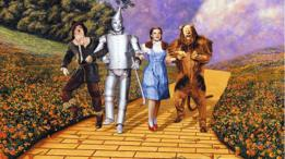 Afiche promocional de El Mago de Oz. Dorothy, el espantapájaros, el hombre de hojalata y el león.