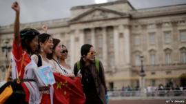 Chinese tourists in front of London's Buckingham Palace