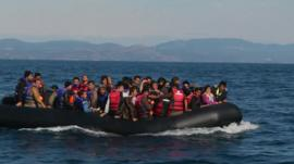 Migrants on boats off the shores of Lesbos