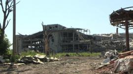 Destroyed Donetsk airport showing shattered remains of buildings and trees