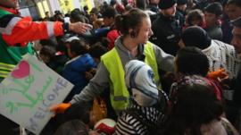 Migrants arriving from Hungary are greeted by crowds at Munich station
