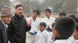 Rajesh Pundir with slum children