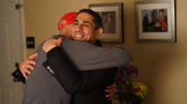 Jeff and Alaa hug