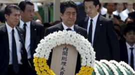 Japanese Prime Minister Shinzo Abe offers a flower wreath for the victims of the 1945 atomic bombing at Nagasaki's Peace Park in Nagasaki - 9 August 2015