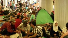 Migrants rest near Keleti train starion in Budapest, Hungary