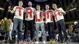 Trump supporters wear T-shirts with his name on at a rally in Lynchburg, Virginia