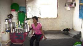 An Eritrean refugee in her room