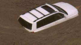 Cars is engulfed in an enormous mudslide