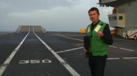 Ed Thomas on board aircraft carrier