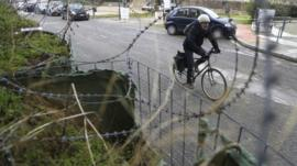 A cyclist crosses the Ledras palace checkpoint in Nicosia, Cyprus