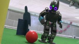 A robot playing football