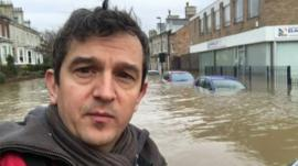 Matthew Price on flooded street