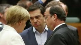 Greek Prime Minister Alexis Tsipras (C) talks with German Chancellor Angela Merkel (L) and French President Francois Hollande